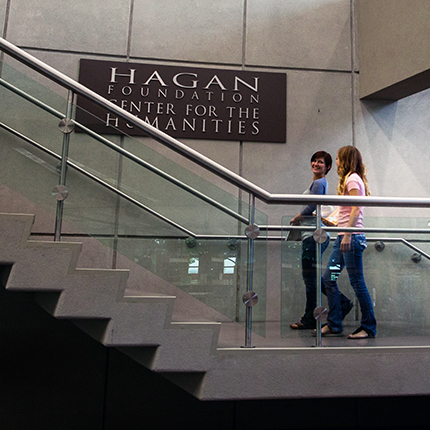 students walking up the stairs in the SCC library by the Hagan Foundation Center for the Humanities sign