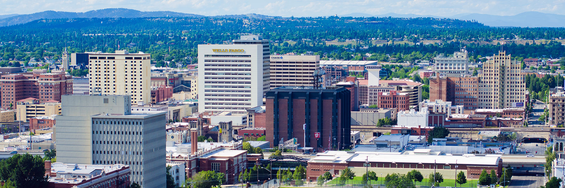 A wide view of the downtown Spokane skyline during the day.