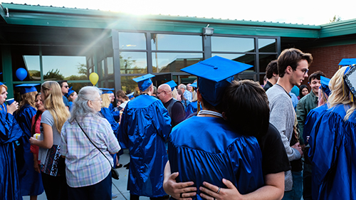 Graduates and their family members outside the Colville SCC location on graduation day
