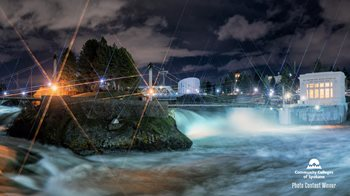Nighttime photo of the waterfall in Riverfront Park