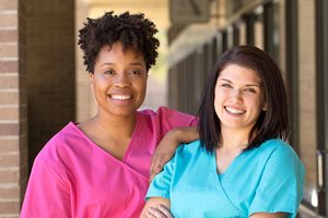 Two nurses outside